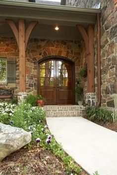 Front doors with rain glass. Would like side windows or window up top. Tom likes these wood columns across front of house