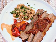 Moroccan spices and a coffee rub lend deep flavor and a russet hue to beef brisket, while couscous helps sop up its sauce.