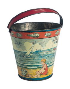 Antique SandPail, seashell edge, and child with sand pail  on the beach....Theriault's Antique Doll Auctions