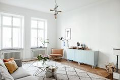 One more for Meg's inspiration file. Scandi style. Tick. White and wood. Tick. A lovely accent ...