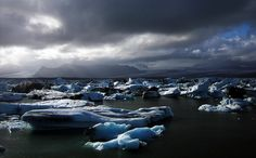 A view of Jökulsárlón, a lagoon filled with icebergs, drifting slowly out to sea. Only in existence for 75 years, since the glacier Vatnajökull started retreating, the lagoon is increasing in size every year.