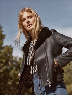 madewell shearling motorcycle jacket worn with the whisper cotton long-sleeve tee + asymmetrical jean skirt.
