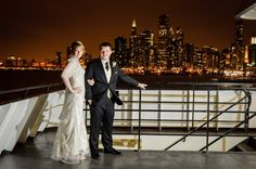 Beautiful bride and groom pose on the top deck of the Odyssey with the Chicago skyline as the backdrop  http://corlisandmegangray.com