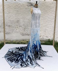 "This elegant evening gown, called ""Herself,"" is an experiment. By coating the dress with a special concrete mixture (yes, concrete!), designer Catalytic Clothing claims it can, allegedly (stress: allegedly), suck up nitrogen oxide and CO from the surrounding air."