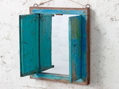 A green and blue surface distressed shabby chic wall mirror with shutters. Shabby Vintage, Vintage Metal, Shabby Chic Mirror, Vintage Mirrors, Wooden Desk, Cheap Home Decor, Home Decor Accessories, Shutters, Projects To Try