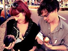 Matthew's sister cradling her baby while Matthew cradles…. an apple. Why am I not surprised?