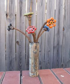 Outdoor water faucets repurposed into flowers.