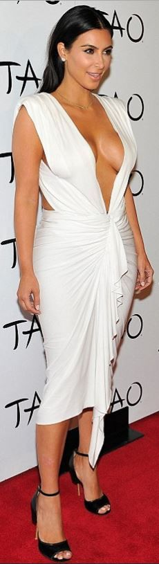 Who made Kim Kardashian's black velvet sandals and white ruched plunge dress that she wore in Las Vegas