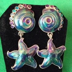 """Vintage Berebi Earrings Gorgeous Berebi shell and starfish post earrings in stunning teal purple, green, and blue on silver background.  All 4 parts are individually stamped """"©Berebi"""" on back.  Approx. 2-1/4"""" long x 1-1/4"""" wide.  Absolutely gorgeous...they shimmer, shine, and sparkle, especially under natural light! Berebi Jewelry Earrings"""