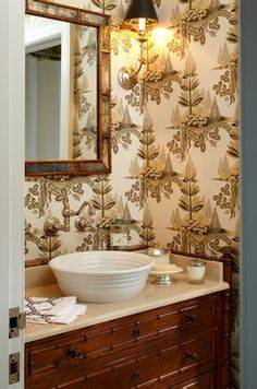 Elegant powder room - Michael Whaley Interiors, vessel sink from Ann Sacks, antique faux bamboo chest for base, Zoffany wallpaper