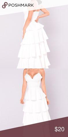 White maxi dress Long white flounce dress. Never worn. Has tags. Dresses Maxi