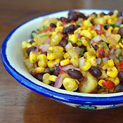 Roasted Corn, Pineapple and Black Bean Salad, Recipe from Cooking.com 3 teaspoons olive oil 2 cups sweet corn kernels or about 3 to 4 ears 1 1/2 cups 1/2-inch thick fresh pineapple chunks 1 (15-ounce) can black beans, drained and rinsed 1/2 cup diced red onion 1/2 cup diced roasted red bell pepper 1/4 teaspoon chipotle powder 2 tablespoons chopped fresh cilantro, or to taste 2 tablespoons lime juice