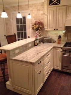 My DIY #kitchen. Two tier peninsula, Viking range, stools from wayfair.com. Antique white grainy counter tops and off white and slightly distressed cabinets. #homeimprovementkitchendiy