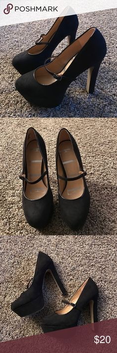 Elle black suede heels Elle size 7.5 black suede heels. The heel is 5.5 inches with 1.5 of those inches being under the ball of your foot. Worn for one night for 2 hours. Small black strap goes across the front of the shoe. Elle Shoes Heels