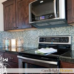 We love this gorgeous blue backsplash! It's the perfect kitchen accent. Candlelight Homes. Utah Homes. New Homes Utah. Utah Builder. Home Decor. Interior Design. Design. Utah. Kitchen. Backsplash. Tile.