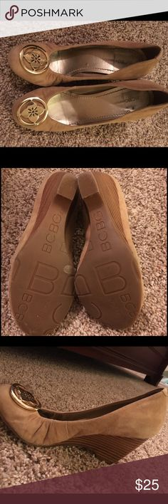 """BCBGeneration - Tan Suede Wedges w Logo BCBGeneration tan suede heels w logo embellishment over toe. Size 6.5. Stacked wedge ~ 3-4"""". Very cute, very comfortable; great for work or event with pants or a dress / skirt. Show minimal signs of interior wear (see photo), very little (if any) signs of external wear. I believe I wore them once to a wedding, but have lost weight so they no longer fit. :( Make an offer! 😊 They are super cute! BCBGeneration Shoes Wedges"""