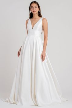 The best way to update the classic taffeta ballgown? Define the waist, add pockets, and most importantly, make it backless! Simply stunning for your special day in the Channing gown.