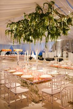 The dance floor was embellished by an all green chandelier doused with stringer lights. | Peach Bliss | White Lilac Inc. | Event Design for Weddings, Fashion, Social, Corporate