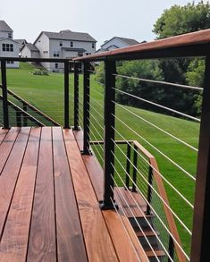 A deck can add value and beauty to any outdoor living space, but on its own, it can sometimes feel a bit lonely. Luckily, the array of wooden deck railing ideas and options provide infinite possibilities for livening up your deck Wire Deck Railing, Deck Railing Design, Patio Deck Designs, Cable Railing, Railings For Decks, Aluminum Deck Railing, Deck Railing Ideas Diy, Cable Fencing, Horizontal Deck Railing