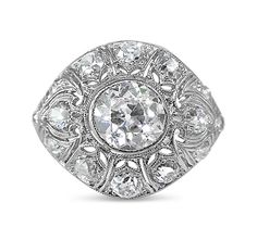 Specifications Description History Circa: 1920s Gemstone: Diamonds Cut: OldEuropean CutWeight & Colour: Central Diamond= 1.16ct,I/VS214 Diamonds = 1.10ct F-K/SI-P1 Material: Platinum Handmade settingIan AbeshouseValuationRing Size: K* Free Resizing Available - So that you receive the perfect fit, please let u