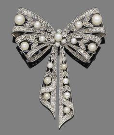 A belle époque pearl and diamond bow brooch,