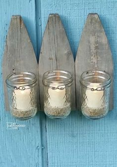 How to make a picket fence candle sconce using reclaimed fence and jelly jars. Easy project to decorate your garden or patio using flame less candles.