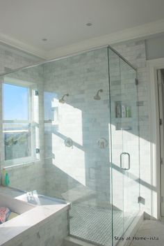 Master bath, marble tile, glass shower.