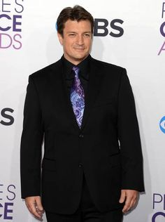 """Nathan Fillion won Best Dramatic TV Actor for his role as Richard Castle in the show """"Castle"""" at the People's Choice Awards on January 9, 2013."""