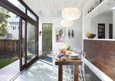 lucite chairs  / farm table in a modern kitchen // feldman architecture old bernal house via mstetson.com - plus loads of light!