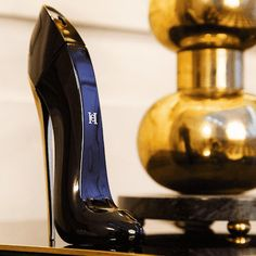 Carolina Herrera Good Girl - Good Girl was conceived by Carolina Herrera Baez, the daughter of the house's founding designer and the creative director of the brand's fragrance collection. Housed in a bottle that resembles a stiletto, the fragrance includes notes of tuberose and jasmine sambac given an edge with the addition of cocoa and roasted tonka beans.