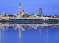 Antwerpen skyline reflecting in river Schelde in the evening - stock photo Paris Skyline, New York Skyline, Skyline Image, World Cities, Lonely Planet, Rotterdam, Places To Visit, Castle, Tours