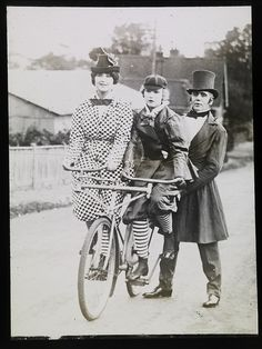 I bet this is the first bike that you've seen looking quite like this. A mother and daughter (with father?) enjoy a ride.