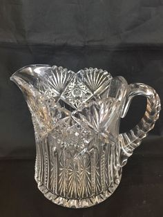 """We are offering this American Brilliant cut glass milk pitcher in the Hindoo pattern by J. Hoare. It measures 6 1/4"""" by 4 7/8"""" diameter, it is in excellent condition. No chips, cracks, repairs or damage. It is not signed. A great value for your collection. 