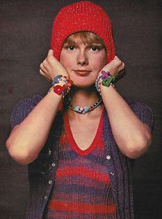 July 1973. 'Want to sparkle? Wear something with Lurex.' 70s vintage fashion style knit sweater metallic blue red set hat color photo print ad model magazine retro look 40s 50s