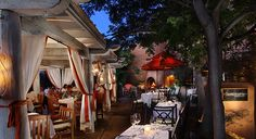 Luminaria, the restaurant of the Inn and Spa at Loretto has one of the loveliest patios in the city, illuminated by chandeliers, candles and an immense kiva-style fireplace.