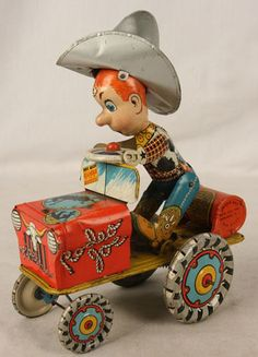 ANTIQUE TIN COWBOY TRACTOR WIND UP TOY