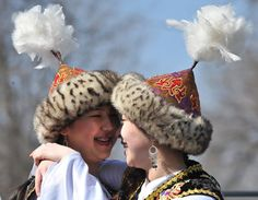 Traditionally dressed Kyrgyz women dance in Bishkek during the annual celebration of Nowruz (New Year)
