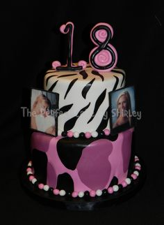 """Pink camo 18th birthday cake - 18th birthday cake incorporating favorite elements of the birthday girl. Covered in fondant - the pink camo didn't come out like I hoped, but it worked. Photos are edible images attached to gumpaste backings, then I used RI to make the """"frame."""""""