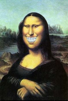 When I visited the Louvre art gallery in France I asked if it was okay to take a picture and they said it was. I must say, the Mona Lisa looks pretty damn good on my dental office waiting room wall.