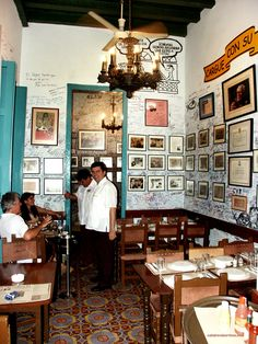 La Bodeguita del Medio, iconic restaurant and bar where the mojito was born. Located in Old Havana the bar has been a typical hang out for actors, writers and artists, one of them being Ernest Hemingway. It's time to visit yourself!