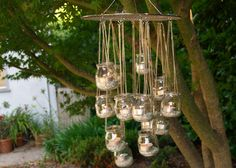 "Spotted over on DIY Weddings, this DIY project is easy, affordable, and eco-friendly! Plus, it is a great budget-friendly way to add ""chandeliers"" to your wedding decor. And you can hang them in your garden after your day has passed. (not a fan of the pan, maybe spray paint it? or just use the baby food jar candle holders on the tables?)"