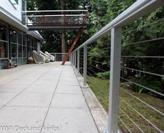 Stainless steel cable installed into an anodized aluminum railing. Anodized finish is superior to stainless steel in many respects. Alumarail cable railing.