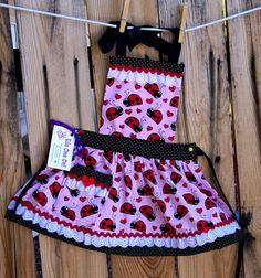 Little+Girl+Ladybug+Apron+with+Ruffles+and+Lace-Size+Small.  So, so, so adorable!  Perfect for little girls who love ladybugs!