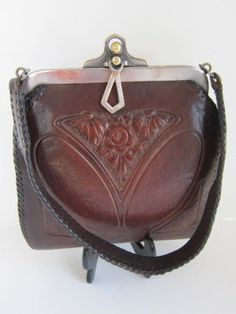 Arts and Crafts vintage leather purse with embossed floral motif. $95.00, via Etsy.