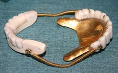 Springs and gold were used to attach dentures and help hold them in the mouth. George Washington's last denture.