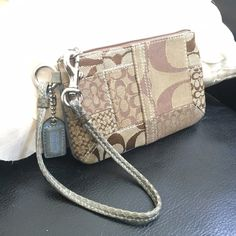 Coach Signature Patchwork Wristlet in Khaki/Blue Super Adorbs Authentic Coach Signature Patchwork Wristlet in Khaki with Baby Blue Python Snakeskin and Suede accents. One of my favorite pieces! Has a good amount of patina on handle & hangtag from use. Some staining in the interior near the zipper as seen in photo. Otherwise in good condition! Coach Bags Clutches & Wristlets