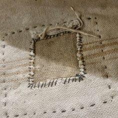 Love this repair on a veru old feed sack