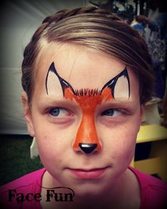 A cute fox face painting design. Painted by Lizz Daley of facefunutah.com.