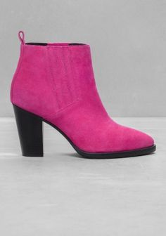 Crafted from luxe suede, these vibrantly coloured ankle boots feature a block heel and a pointy toe.