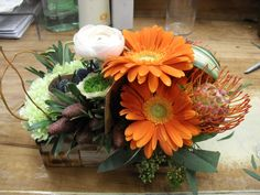 orange and white flower arrangement for wedding and events